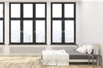 Panoramiczne okna wąskoprofilowe w nowoczesnym domu. Jak doświetlić wnętrze?