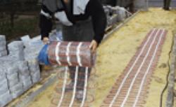 System ogrzewania i osuszania nawierzchni - podgrzewana kostka brukowa